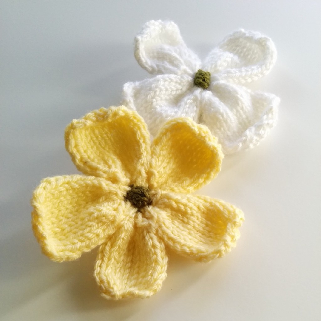 this knitted flower is great for brooches additions to hats and scarves or use it in place of a bow on gift boxes the knitted dogwood blossoms pattern - Dogwood Flower